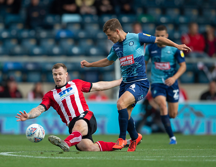 Lincoln City's Michael O'Connor battles with Wycombe Wanderers' Dominic Gape<br /> <br /> Photographer Andrew Vaughan/CameraSport<br /> <br /> The EFL Sky Bet League One - Wycombe Wanderers v Lincoln City - Saturday 7th September 2019 - Adams Park - Wycombe<br /> <br /> World Copyright © 2019 CameraSport. All rights reserved. 43 Linden Ave. Countesthorpe. Leicester. England. LE8 5PG - Tel: +44 (0) 116 277 4147 - admin@camerasport.com - www.camerasport.com