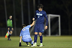 CARY, NC - NOVEMBER 19: UNCW's Mark Lindstrom (2) helps North Carolina's Cam Lindley (6) up. The University of North Carolina Tar Heels hosted the UNCW Seahawks on November 19, 2017 at Koka Booth Stadium in Cary, NC in an NCAA Division I Men's Soccer Tournament Second Round game. UNC won the game 2-1.