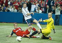 07 March 2012: LA Galaxy forward Robbie Keane #7 battles with Toronto FC defender Ty Harden #20 in front of Toronto FC goalkeeper Stefan Frei #24 during action in a CONCACAF Champions League game between the LA Galaxy and Toronto FC at the Rogers Centre in Toronto..The game ended in a 2-2 draw.