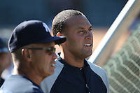 OAKLAND, CA - JULY 5:  Special assistant Reggie Jackson and Derek Jeter #2 of the New York Yankees watch batting practice before the game against the Oakland Athletics at the Oakland-Alameda County Coliseum on July 5, 2010 in Oakland, California. Photo by Brad Mangin