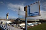 Signs indicating the rows 'L' and 'M' on the traditional away end of the stadium, pictured before Greenock Morton take on Stranraer in a Scottish League One match at Cappielow Park, Greenock. The match was between the top two teams in Scotland's third tier, with Morton winning by two goals to nil. The attendance was 1,921, above average for Morton's games during the 2014-15 season so far.