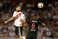 "BUENOS AIRES - ARGENTINA - 05 - 04 - 2018: Lucas Pratto (Izq.) jugador de River Plate disputa el balón con William Tesillo (Der.) jugador de Independiente Santa Fe, durante partido de la fase de grupos, grupo D, fecha 2, entre River Plate (ARG) y el Independiente Santa Fe, por la Copa Conmebol Libertadores 2018, en el estadio Antonio Vespucio Liberti ""Monumental de River"", de la ciudad Ciudad Autónoma de Buenos Aires. / Lucas Pratto (L) player of River Plate vies for the ball with William Tesillo (R) player of Independiente Santa Fe, during a match of the groups phase, group D, 2nd date, beween River Plate (ARG) and Independiente Santa Fe, for the Conmebol Libertadores Cup 2018, at the Antonio Vespucio Liberti ""Monumental de River"", in Ciudad Autónoma de Buenos Aires.  Photo: VizzorImage / Javier Garcia Martino / Photogamma / Cont."