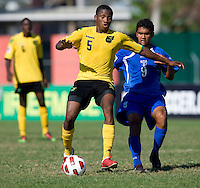 Alvas Powell (5) of Jamaica looks for a pass in front of Julio Moncada (9) of Honduras during the quarterfinals of the CONCACAF Men's Under 17 Championship at Catherine Hall Stadium in Montego Bay, Jamaica. Jamaica defeated Honduras, 2-1.