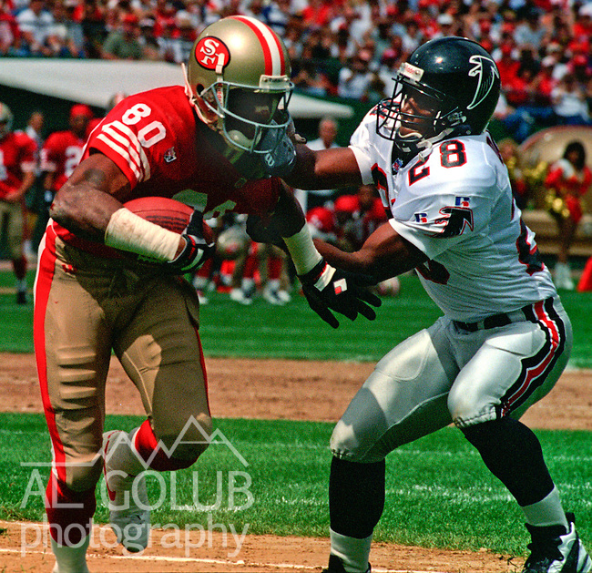 San Francisco 49ers vs. Atlanta Falcons at Candlestick Park Sunday, September 10, 1995.  49ers beat Falcons 41-10.  San Francisco 49ers wide receiver Jerry Rice (80) gets away from Atlanta Falcons defensive back Ron Davis (28).