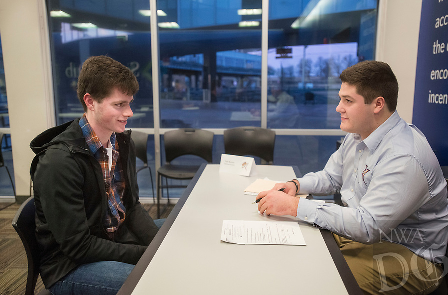 NWA Democrat-Gazette/BEN GOFF @NWABENGOFF<br /> Jake Youngs (left) of Rogers sits down for an interview with Tyler Burson, Northwest Arkansas Naturals clubhouse assistant, Thursday, Feb. 8, 2018, during the annual Northwest Arkansas Naturals job fair at Arvest Ballpark in Springdale.