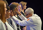 United Methodist Bishop Violet Fisher consecrates Jane O. Grays as a deaconess during an April 27, 2014, worship service at the United Methodist Women's Assembly in the Kentucky International Convention Center in Louisville, Kentucky. Grays is an outreach aide at McKendree-Simms-Brookland Outreach House, Washington, D.C.