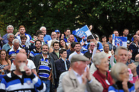 Bath fans in the crowd show their support. Aviva Premiership match, between Bath Rugby and Leicester Tigers on September 20, 2014 at the Recreation Ground in Bath, England. Photo by: Patrick Khachfe / Onside Images