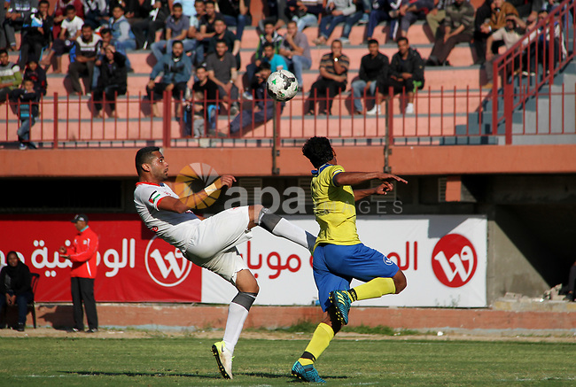 """Palestinian players of Shabab Jabalia club """"yellow"""" and players of Shabab Khan Younis club """"white"""" compete during a football match of semi final Gaza Cup, at Palestine stadium, in Gaza city on April 23, 2018. Photo by Mahmoud Ajour"""