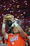 Clemson Tigers quarterback Trevor Lawrence (16) holds up the trophy after the Fiesta Bowl game against the Ohio State Buckeyes on Saturday, Dec 28, 2019 in Glendale, Ariz.  (Gene Lower via AP)