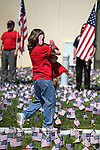 Crystal Smith and her daughter Jayde, 2, participate in a Veterans Suicide Awareness walk in Carson City, Nev., on Saturday, May 2, 2015. The event, hosted by the Western Nevada College Veterans Resource Center, raises awareness of the more than 8,000 veteran suicides each year in the U.S. <br /> Photo by Cathleen Allison