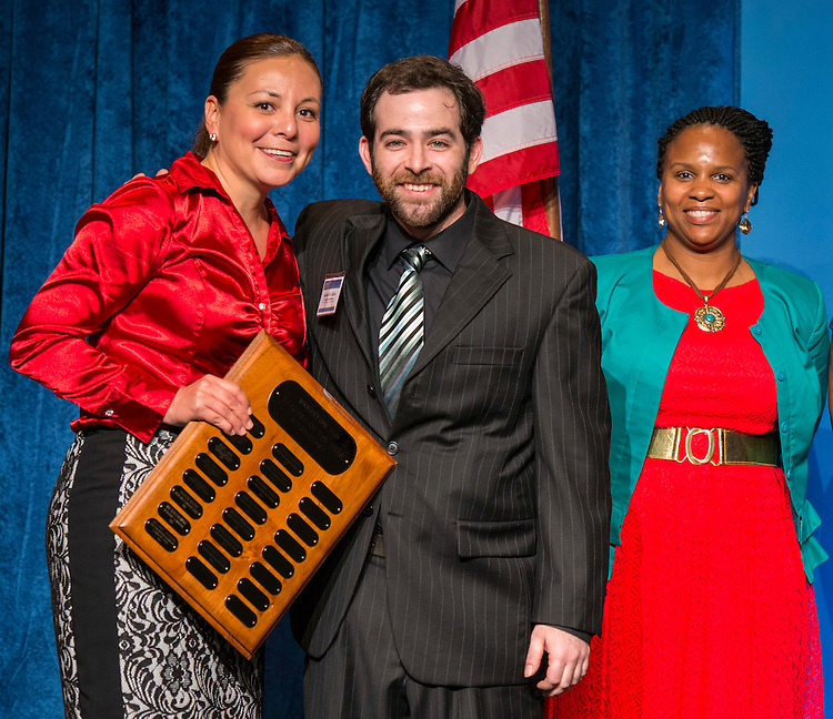 Cunningham principal Anna White , left, poses with Elementary Teacher of the Year Robert Uzick, center, during the Celebration of Excellence, May 15, 2015.