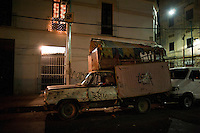 A beaten-up old truck parked on the street. Night bicycle rides rides with Kurt Adrian and Mike.  Alamenda, teatro Blanquita, Garibaldi, Tlaltelolco.  Mexico City.