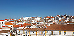 Panoramic style cityscape views over pan tile rooftops and whitewashed buildings in the city centre of Evora, Alto Alentejo, Portugal, southern Europe
