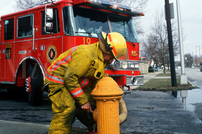 Firefighter in Columbus, Ohio, opens fire hydrant.<br />