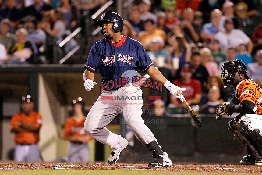 Pawtucket Red Sox infielder Hector Luna #5 at bat in front of catcher Jair Fernandez during a game against the Rochester Red Wings at Frontier Field on August 30, 2011 in Rochester, New York.  Rochester defeated Pawtucket 8-6.  (Mike Janes/Four Seam Images)