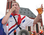 21 June 2006: A Holland fan with a megaphone leads the crowd in Frankfurt's town square in song. The Netherlands played Argentina at Commerzbank Arena in Frankfurt, Germany in match 37, a Group C first round game, of the 2006 FIFA World Cup.