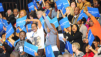 LAURA FONG | Democratic supporters dance and sing while awaiting a visit from First Lady Michelle Obama at Cuyahoga Community College in Cleveland.