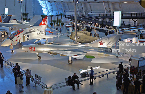 "Chantilly, VA - December 11, 2003 -- A Mikoyan-Gurevich MiG-21F ""Fishbed C"" fighter, center, and a McDonnell F-4S Phantom II fighter, left, are on display at the Steven F. Udvar-Hazy Center in Chantilly, Virginia on December 11, 2003.  .Credit: Ron Sachs / CNP.(RESTRICTION: NO New York or New Jersey Newspapers or newspapers within a 75 mile radius of New York City)"