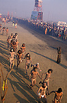 Sadhus on their way to bathe at the Sangam where the Ganges, Yamuna and Saraswati Rivers meet. It was estimated that over 100,000 Sadhus and holy men attended the Maha Kumbha Mela in 1989. Maha Kumbha Mela is held every twelve years at Prayag (Allahabad) in Uttar Pradesh in India.