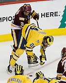 Brady Lamb (Duluth - 2), Jon Merrill (Michigan - 24) - The University of Minnesota-Duluth Bulldogs defeated the University of Michigan Wolverines 3-2 (OT) to win the 2011 D1 National Championship on Saturday, April 9, 2011, at the Xcel Energy Center in St. Paul, Minnesota.