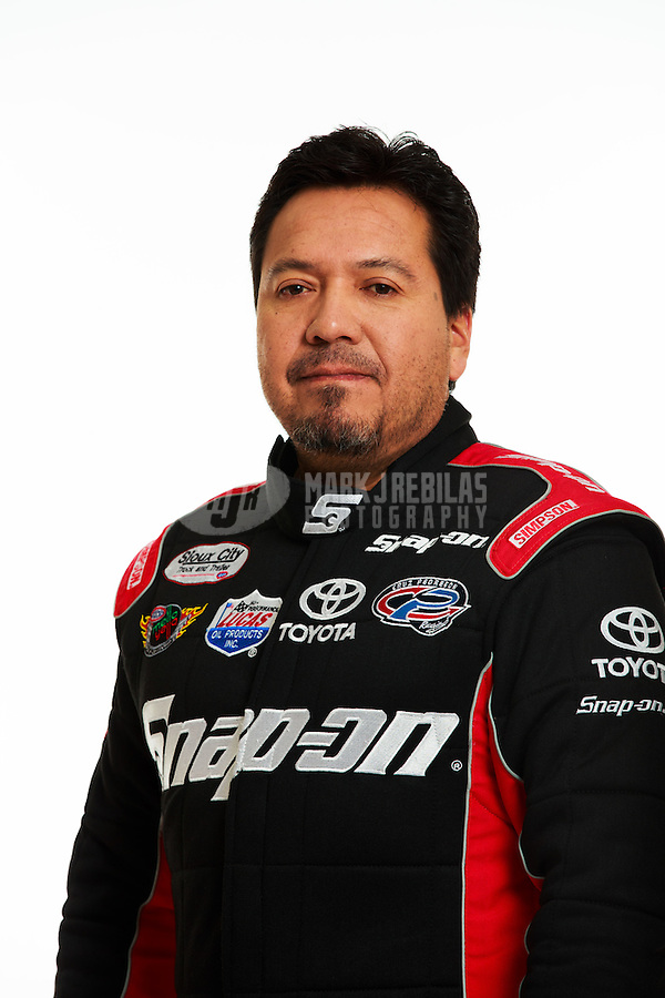 Jan 16, 2014; Palm Beach Gardens, FL, USA; NHRA funny car driver Cruz Pedregon poses for a portrait. Mandatory Credit: Mark J. Rebilas-