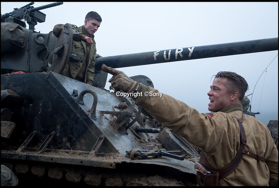 BNPS.co.uk (01202 558833)<br /> Pic: Sony/BNPS<br /> <br /> ***Please Use Full Byline***<br /> <br /> A still taken from the film Fury of Norman (Logan Lerman) and Wardaddy (Brad Pitt).<br /> <br /> Meet the real driving force behind Brad Pitt's new Second World War blockbuster, Fury.<br /> <br /> Tank mechanics Brian Frost, 39, and Ian 'Buzz' Aldridge, 53, were hired to drive the famous Sherman tank the movie is named after for most of the major scenes.<br /> <br /> The pair, who work at Bovington Tank Museum in Dorset, spent six months taking it in turns to operate the 26 ton tank in front of the cameras.<br /> <br /> Although the two never appear in the movie, every time 'Fury' is seen in motion and without actor Michael Pena in the driving seat,<br /> Brian or Buzz are at the controls.<br /> <br /> The pair also trained actor Pena the basics of driving the Sherrman tank to give the close-up shots of his character Corporal Trini 'Gordo' Garcia more legitimacy.<br /> <br /> The museum lent the movie's producers their M4 Sherman tank to act as Fury as well as the services of Brian and Buzz.