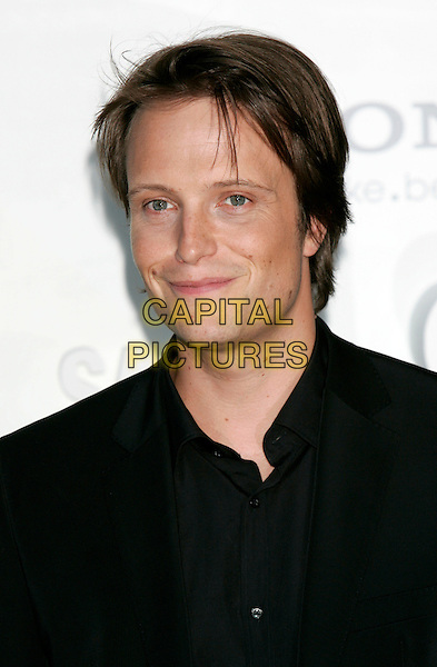 "AUGUST DIEHL.""Salt"" German Film Premiere held at the .Sony Center, Berlin, Germany,.August 18th, 2010..portrait headshot black shirt .CAP/PE.©Peter Eden/Capital Pictures."