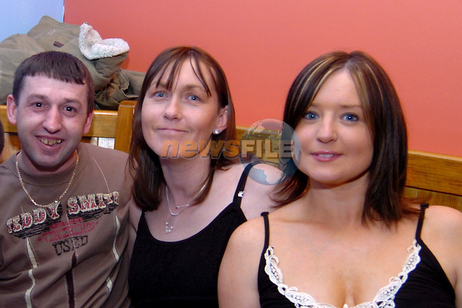 "Thomas Mc Cormack, Collette Mc Cormack and Elaine White at ""Echo Beach"" fundraiser for tsunami in the Rugby club.. Photo: Colin Bell / Newsfile.Photo: Colin Bell / Newsfile"