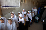 "15 June 2013, Dari Cha Noor School, Qargha, Kabul Province,  Afghanistan. School students prepare for class at the Dari Cha Noor (""Window to Knowledge"") School. The school has begun to formulate plans to improve and expand under the  Education Quality Improvement Program (EQUIP). Currently they have only organised the shura council but already they have enrolled another 75 students in the last three months. The school will benefit from the EQUIP whose objective is to increase access to quality basic education, especially for girls. School grants and teacher training programs are strengthened by support from communities and private providers.  Picture by Graham Crouch/World Bank"