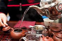 Detail of tea making at the Tea Art Gallery tea shop, Hong Kong.