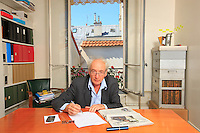 "Henry Meynadier, 62 years old, general director of the public relations company Anatome, in his office where he has set up a hive. ""I spent my childhood in the Cévennes, and I probably had my first hive at the age of 10. Beekeeping is my family history, my roots... I set up this hive 4 years ago, following a lunch with Henri Clément, national director of the UNAF (National Union of French Apiculture). The discussion at that lunch centered on his concern to be able to resist the pesticides lobby and those international corporations that ruin our environment. Since I have a public relations company that works a lot on the big questions of public interest, I offered in an activist manner to contribute to their communications, to examine with him the manner in which we could establish a line of resistance to these lobbies."