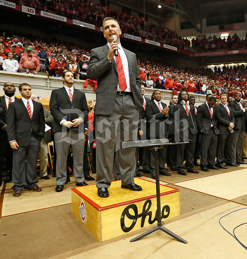 Ohio State University Head Football coach, Urban Meyer ,addresses the band and fans prior to their game against Iowa in St John Arena at the Skull Session on October 19, 2013.  (Chris Russell/Dispatch Photo)
