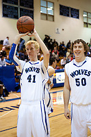 Grandview High School unified basketball players Shane Powell (cq, 41) and Taylor Schultz (cq, 50) warm up before a game against Overland High School at Grandview High School in Aurora, Colorado, Wednesday, February 1, 2012. Unified sports teams, an outgrowth of the Special Olympics, are teams with both special needs and traditional high school students as players. The idea is that special needs kids shouldn't be separated and be allowed to participate in a competitive games as well at their schools...Photo by Matt Nager