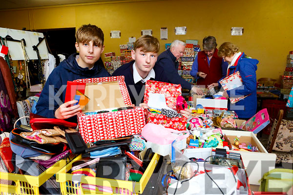 St Brendans College students Keith Myers and Adam Grzesiak who have been helping to sort out the shoeboxes people have donated to Team Hope which will be sent to Albania this year