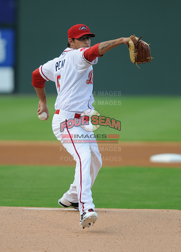 Pitcher Mickey Pena (5) of the Greenville Drive in a game against the Rome Braves on August 13, 2012, at Fluor Field at the West End in Greenville, South Carolina. Rome won, 3-2. (Tom Priddy/Four Seam Images)