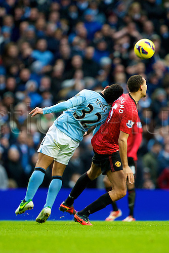 09.12.2012 Manchester, England. Manchester City's Argentinean forward Carlos Tévez and Manchester United's English defender Rio Ferdinand in action during the Premier League game between Manchester City and Manchester United from the Etihad Stadium. Manchester United scored a late winner to take the game 2-3.