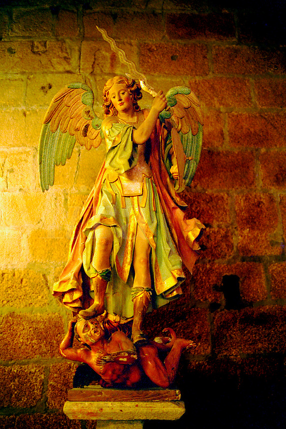 Spain, Tuy. Statue of sword wielding archangel Michael in the cathedral. Tuy, Spain.