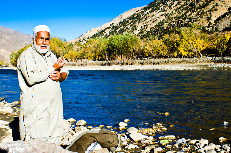 Afghan man portrayed after finishing his ablutions in the Panjshir river.