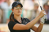 Apr. 1, 2006; Rancho Mirage, CA, USA; The 17th hole can be seen in Michelle Wie's sunglasses as she watches her tee shot at the Kraft Nabisco Championships at Mission Hills Country Club.  ..Mandatory Photo Credit: Darrell Miho.Copyright © 2006 Darrell Miho .