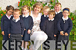Pictured during their first day in Fybough National School, Castlemaine on Tuesday were Juliette Hickey, Keith O'Shea, Ava Ladden, Oisin Foley, Gearoid Evans, Michael Griffin and Rose Dearroch with teacher and school principal Mrs Angela Prendergast.........