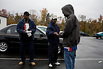 November 4, 2008. Durham, NC.. (left to right) Michael Mitchell and John Springs hand out info to incoming voters to help them with their decisions relating Democratic candidates and the food tax that is up for vote in North Carolina.