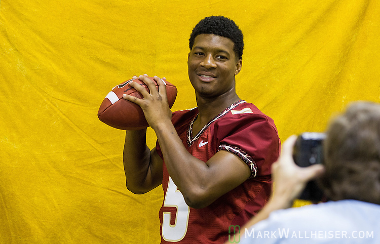 TALLAHASSEE, FL - AUGUST 11, 2013:   FSU quarterback Jameis Winston gets photographed during the 2013 Florida State Football Media Day in the Moore Athletic center on the Florida State campus in Tallahassee, Florida.<br /> <br /> CREDIT: Mark Wallheiser.com