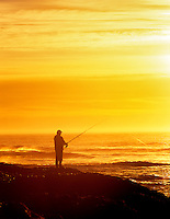 Fisherman on rocky shore of Cape Perpetua. Oregon.