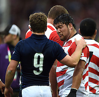 Greig Laidlaw of Scotland commiserates with Kensuke Hatakeyama of Japan after the match. Rugby World Cup Pool B match between Scotland and Japan on September 23, 2015 at Kingsholm Stadium in Gloucester, England. Photo by: Patrick Khachfe / Onside Images
