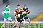 Colm Cooper Dr Crokes goes round Legion's Padraig lucey during the O'Donoghue cup final in Fitzgerald Stadium on Sunday