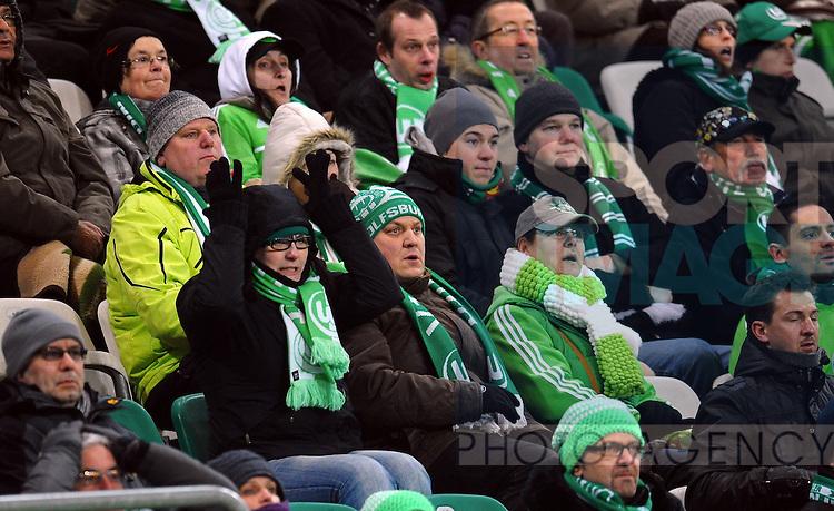 15.03.2013 --- Fussball --- Saison 2012 2013 --- 1. Bundesliga --- 26. Spieltag: VfL Wolfsburg vs Fortuna Duesseldorf..Im Bild: Zum Haare raufen - Fans des VfL Wolfsburg