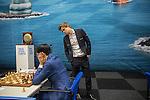 14012017,  Nederland, Wijk aan Zee, Tata Steel Chess tounament<br />  foto Michael Kooren<br /> Noorse superster van het mondiale schaken, Magnus Carlsen,  speelt in Wijk aan Zee voor de 13e keer.<br /> Carlsen kijkt mee op het bord van de Nederlandse meester Anish Giri