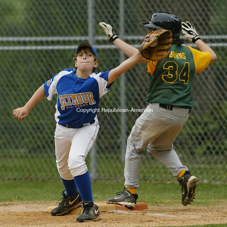 NAUGATUCK, CT 07/17/09- 071709BZ08- Seymour's Chris Ferry (27) tries to make the play at first as Shelton American's Austin Burns (34) crosses the bag safely during the Little League District 3 Championship tuornament at the Peter J. Foley Little League Complex in Naugatuck Friday night.<br /> Jamison C. Bazinet Republican-American