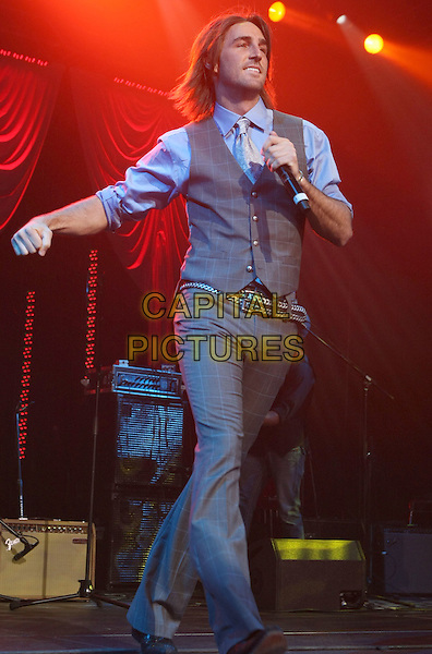 JAKE OWEN.New Artists' Party For a Cause held at MGM Grand Hotel Casino, Las Vegas, Nevada, USA..May 17th, 2008.full length stage concert live gig performance music grey gray waistcoat trousers microphone walking .CAP/ADM/MJT.© MJT/AdMedia/Capital Pictures.