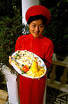 Southeast Asian, Vietnam, Hue, young woman, cuisine, photo# vietna103.Photo Copyright: Lee Foster, www.fostertravel.com, 510-549-2202, lee@fostertravel.com